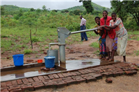 Water-covered shallow well with hand pump